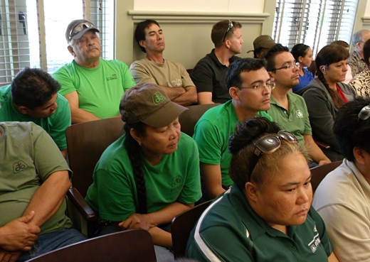 Pioneer employees who were bussed by DuPont County Council meeting for hearing on Bill 2491 to regulate GMO company pesticide use on Kauai Photo by Juan Wilson.
