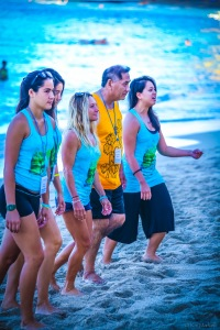Pro surfer Rochelle Ballard (center) leads the opening ceremonies with 'Uncle' Bruce Keaulani of the Living Life Source Foundation.